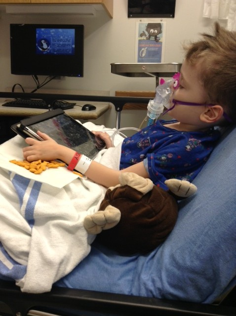 iPad, stuffed monkey, Goldfish crackers and a dragon style nebulizer mask= on the road to recovery.