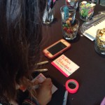 Heather making a badge